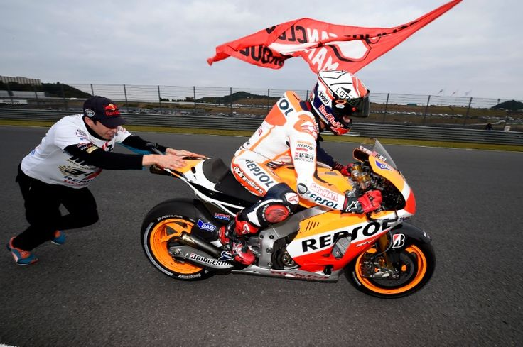 Marquez, 2014 World Champion, with Brother Alex bump starting him, Japanese MotoGP Race 2014