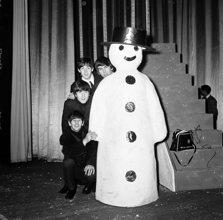 The Beatles pose with a Snowman, as they take a break from rehearsals at the Astoria Cinema, Finsbury Park, London, 19th December 1963. Preparations ahead of The Beatles 1963 Christmas Shows.