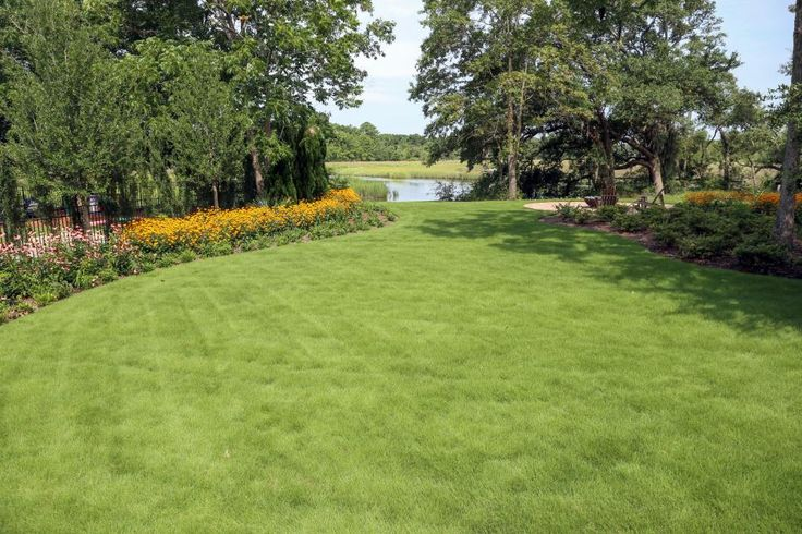 Neat landscaping outlines a healthy lawn near the pond ... on Open Backyard Ideas id=67053