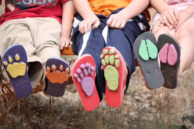cool nature shoes- transform flipflops into animal track shoes using a hot glue gun and sheets of colored craft foam. let each child choose an animal--cougar, porcupine, deer. Let your creative imagination go! People are going to come behind you on the trail and think wild animals were walking here :)