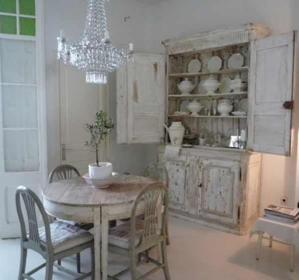 Shabby kitchen looks great with the chandelier