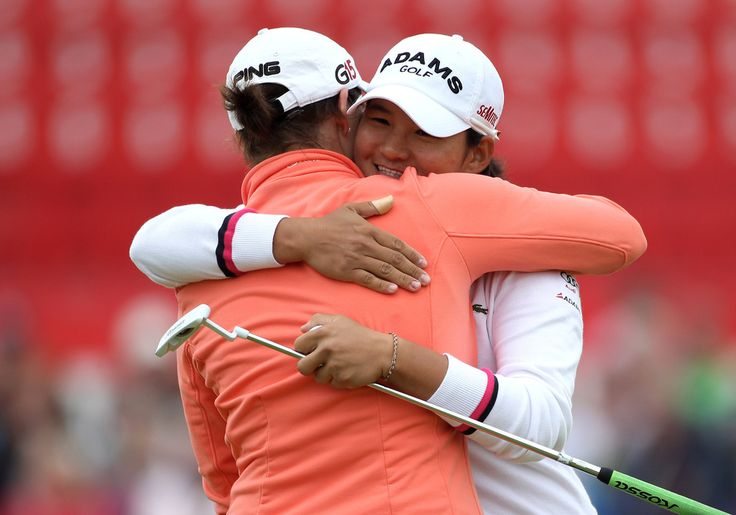 Caroline Masson Photos Photos - Yani Tseng of Taiwan embraces Caroline Masson (L) of Germany on the 18th green following her victory during the final round of the 2011 Ricoh Women's British Open at Carnoustie Golf Links on July 31, 2011 in Carnoustie, Scotland. - Ricoh Women's British Open - Day Four