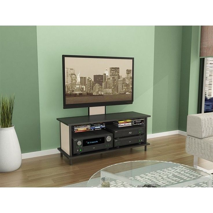 Finished with espresso and beige wood grains, this 3-in-1 TV stand provides storage for components, built-in media storage, and a flat panel TV mount for TVs up to 42 inches.   <li>Frame materials: Steel, wood</li>  <li>Finish: PVC laminate</li> #holiday2015 http://www.overstock.com/6310402/product.html?CID=245307