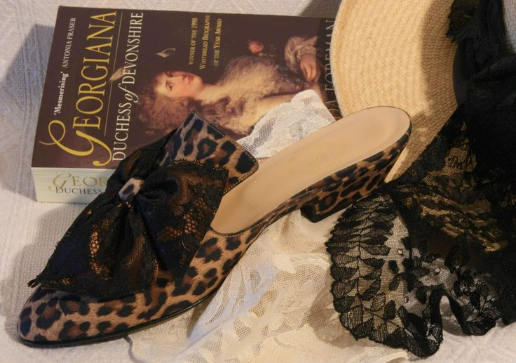 """Torride"" - jaguar print with black Chantilly lace & satin double bow"