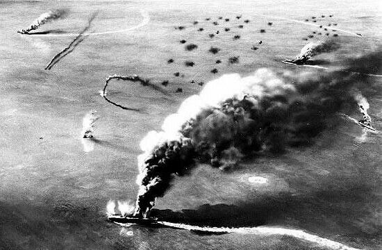 Three Japanese carriers burning during the battle of midway. Look closely left side of picture you can see one plane just as it hits the water and another trailing smoke. In center of picture in the flack u can just make out three SBD's making a diving attack during the battle.