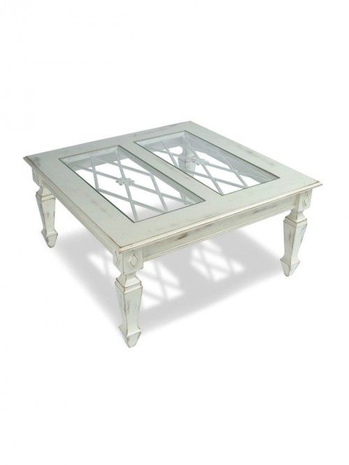dd some farmhouse country style to your home with the Avignon Cocktail Table. It features detailed legs and lattice work under the glass top. Also, it has built-in cast aluminum panels with plate glass insets.