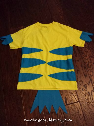 I made this simple Flounder costume with plain yellow t- shirt from Walmart and some flannel blue material from Joann. Total cost $5!  #flounder #floundercostume #littlemermaid