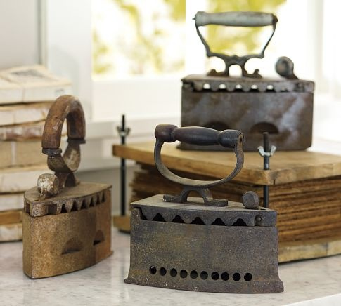 antique irons - kept on the stove so it was always ready to iron. Make the starch and wet the clothes down and roll them up to keep them damp! WOW - haven't thought of that in a while :(