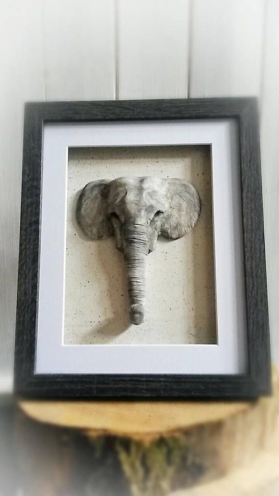 Check out this item in my Etsy shop https://www.etsy.com/uk/listing/519412465/frames-elephant-sculpture-wall-art