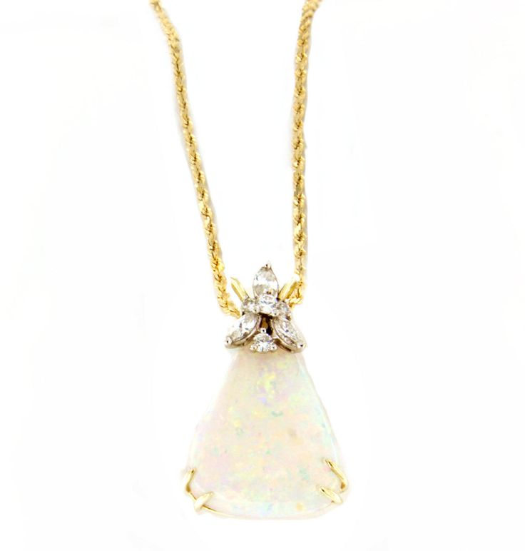 Happy Birthday to all the October ladies! This cabochon white opal & diamond necklace is a beautiful piece to represent the month. #MichaelsJewelers #Opal #October #Necklace