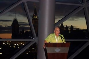 John Halverson giving speech at President's reception at beginning of 2013 Tamarack Ottawa Race Weekend.