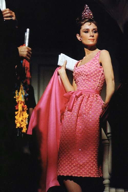 Audrey in pink sheath cocktail dress with matching jacket tank sleeves bow tie belt textured unique color photo vintage fashion icon movie star