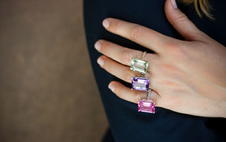 Wearing the white pearl necklace (as bracelet), emerald cut cocktail ring in (from top) green amethyst, amethyst and pink sapphire.