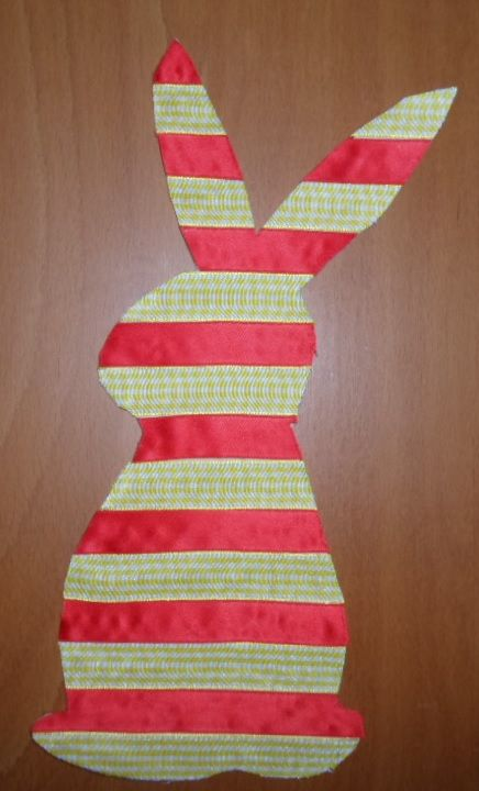 Easter bunny made out of ribbon. (Ribbon glued on cardboard.)