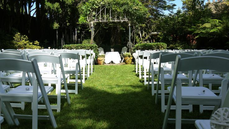 The Gables, Malvern Victoria. Love this cute manicured garden venue in Melbourne. Suitable for High tea, outdoor weddings, and lunch receptions. Little White Americana Chairs, trestle table signing table, premium white table cloth and decorative Love sign by A&B Weddings - the Setting Specialist. Melbourne Outdoor Ceremony Wedding Hire.