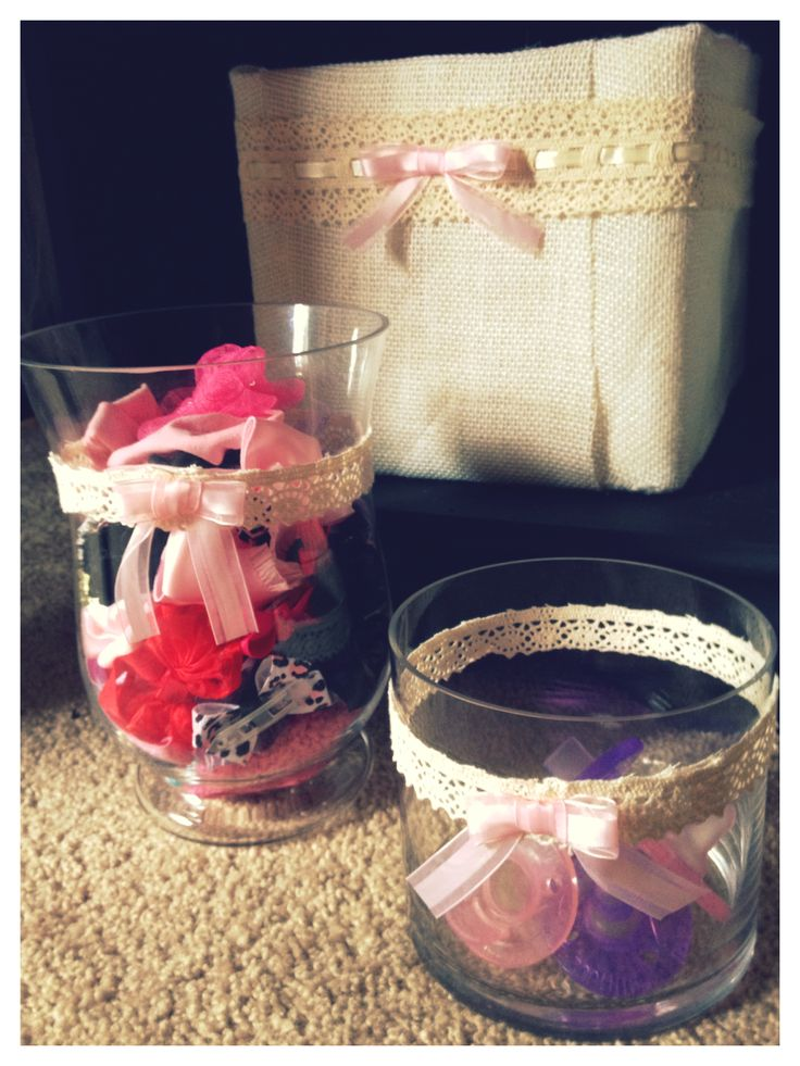 DIY headband and pacifier storage to match DIY burlap covered storage boxes (upcycled from old diaper boxes). Hot glued ribbon to vases I had collecting dust in my cupboards!