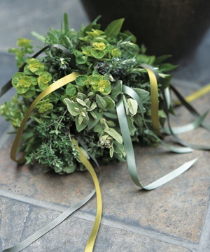 Bridal bouquets have their origins in the posies of herbs once carried on the wedding day to ward off evil spirits. Traditional ribbon streamers decorate this modern version, made of rosemary, golden marjoram, thyme, sage and tarragon.