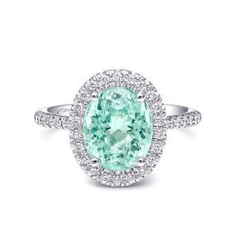 Coast Diamond. This beautiful ring features a 3.26CT paraiba color tourmaline surrounded by diamonds. Set in 14K white gold.
