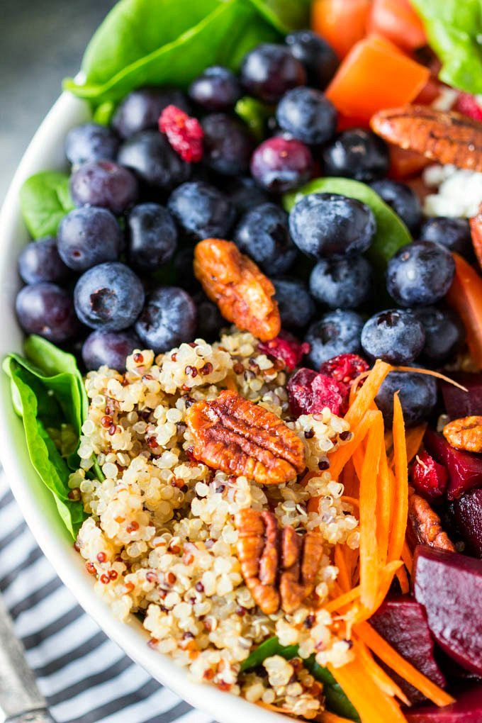Quinoa Spinach Blueberry Superfood Bowl- A big bowl of nutritious goodness! Packed with 9 superfoods (quinoa, spinach, blueberries, carrots, edamame, beets, cranberries, tomatoes and pecans) these bright and colorful bowls not only pack in a lot of healthy nutrition , they are extremely tasty and keep you feeling full thanks to the combination of protein and fiber in these superfoods