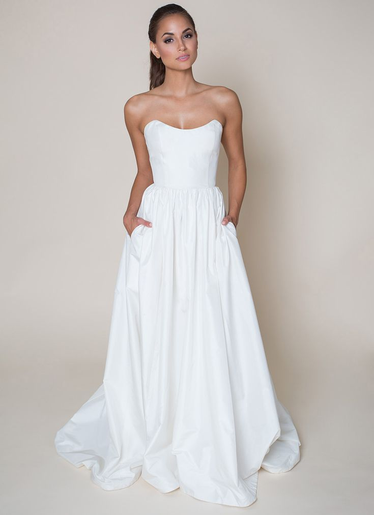 "'LaLa Phillips' Simple and fresh, this A-line wedding dress features a scoop neckline, natural waist, gathered skirt with pockets, and a chapel train. See this gown and other bridal separates from the Build-A-Bride by heidi elnora line on ""Bride by Design"" on TLC!"