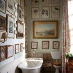 Creative Walls With Various Frame Photos In The Bathrooms With White Bathtub And Closet