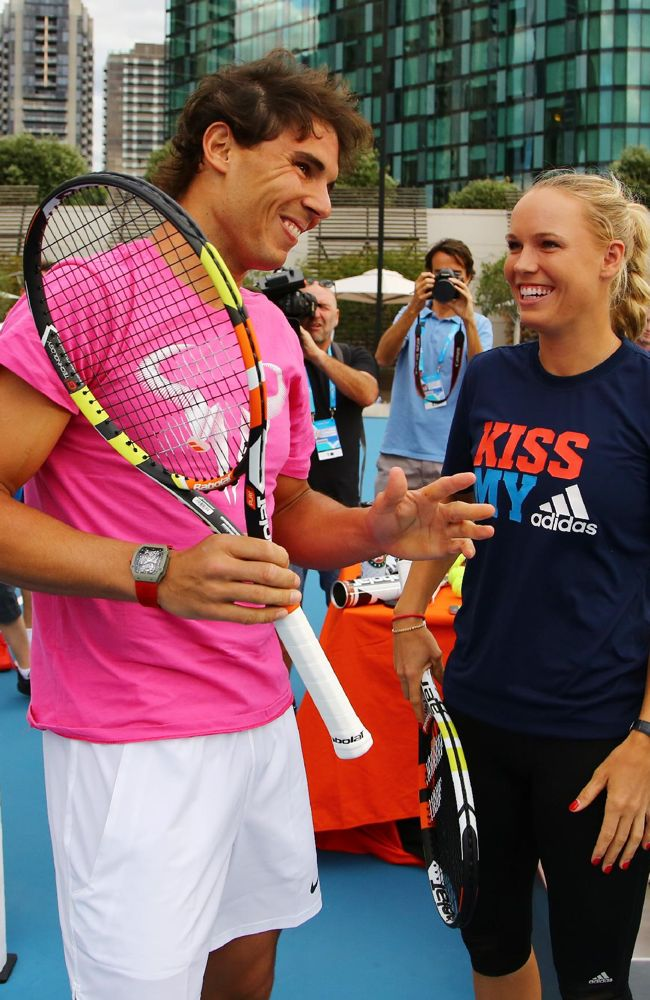 Spain's Rafael Nadal and Denmark's Caroline Wozniacki talk during a promotional event ahead of the Australian Open tennis championship in Melbourne, Australia, Friday, Jan. 16, 2015
