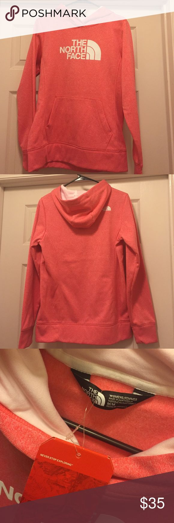 Women's North Face pullover hoodie. NWT. Med. North Face pullover hoodie. Pink/coral color with white logo. NWT. Size medium. Super comfy! It was a gift and doesn't fit me. The North Face Tops Sweatshirts & Hoodies