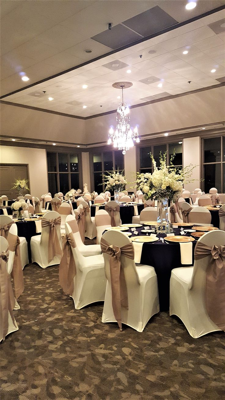 Wedding Reception with Ivory Spandex Chair Covers, Gold Sashes & Black Linens in the Ballroom at Sugar Creek Country Club. #Wedding #ChairCovers #Gold #Black
