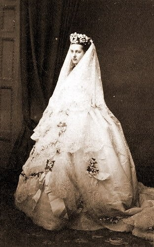 "Photograph of Princess Alexandra Caroline ""Alix"" (Alexandra Caroline Marie Charlotte Louise Julia) (1844-1925) Denmark in wedding dress. Wife of Albert Edward (King Edward VII) (1841-1910) Prince of Wales, UK. 2nd Child of King Christian IX (1818-1906) Denmark & Princess Louise (1817-1898) Hesse-Kassel, Germany."