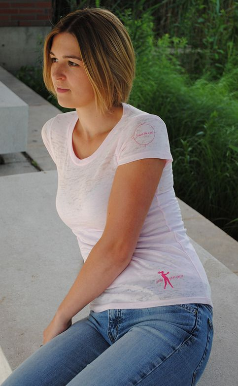 """Layer this piece with a coloured cami for a unique and stylish cammo look or skip the cami all together for a super-sexy vibe. This shirt is fitted to flatter and features the """"I shoot like a girl"""" graphic on the left sleeve as well as the proud but discreet Girly Gun Gear logo on the bottom left..."""