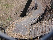 """The only part of the Polo Grounds that still remains as of 2013 is the """"John T. Brush Stairway,"""" which runs down Coogan's Bluff from Edgecombe Avenue to Harlem River Drive at about 158th Street.[26] The stairway, named for the recently deceased owner of the Giants, opened in 1913 and led to a ticket booth overlooking the stadium. The stairway reportedly offered a clear view of the stadium for fans who did not purchase tickets to a game. A marker on the stairway reads: """"The John T. Brush…"""