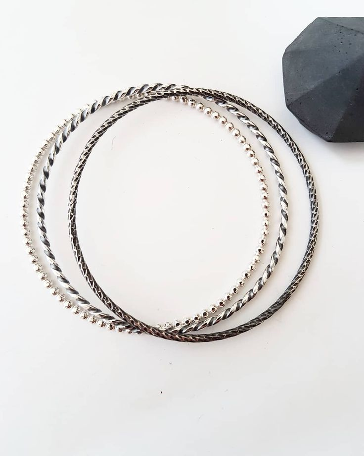 Simple bangles...... . . . #jewellery #bijoux #schmuck #jewelry #design #handcrafted #faitmain #bangles  #blackandwhite #bracelet #minimalist #simplicity #circle #handmade #brittabrandjewellery #silverjewelry #maker #fashion