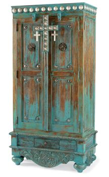 They call it a Cowgirl armoire but it reminds me of those I saw in India. without the crosses