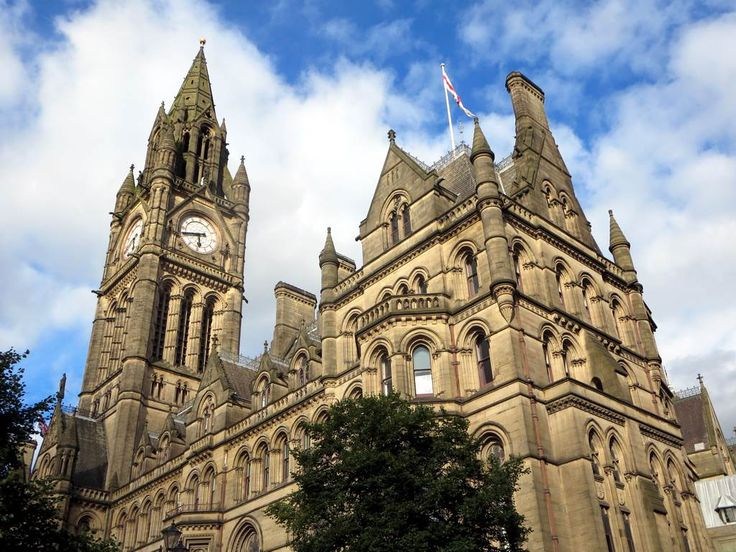 The Town Hall on Albert Square in Manchester, England, is famous for its tower and the pre-Raphaelite wall paintings in the Great Hall.