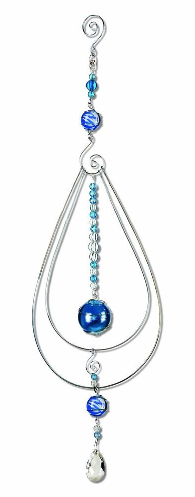 Stratus Spheres Pavo Marble Sun Catcher Mobile  Blue and clear marbles reflect light to add dimension and shine to any window or room.