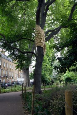"""As cities grow increasingly crowded microhousing is becoming increasingly popular. So much so that it's now being offered to the birds in London. Entitled Spontaneous City in the Tree of Heaven, these two sculptural installations are the work of artists Jo Joelson and Bruce Gilchrist, known collectively as London Fieldworks. Several hundred bespoke bird boxes were mounted on two Ailanthus altissima trees, commonly knowns as the tree of heaven.      """"These houses don't look like your typical…"""