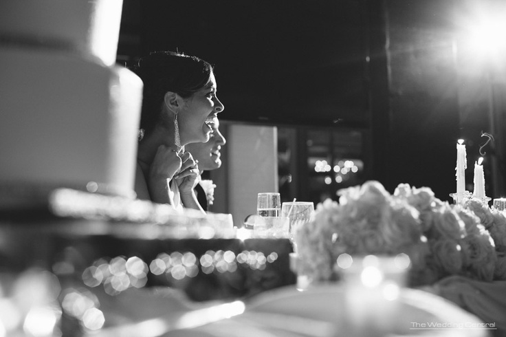 Light - Bride beams while listening to her father's speech during her wedding ~www.theweddingcentral.com