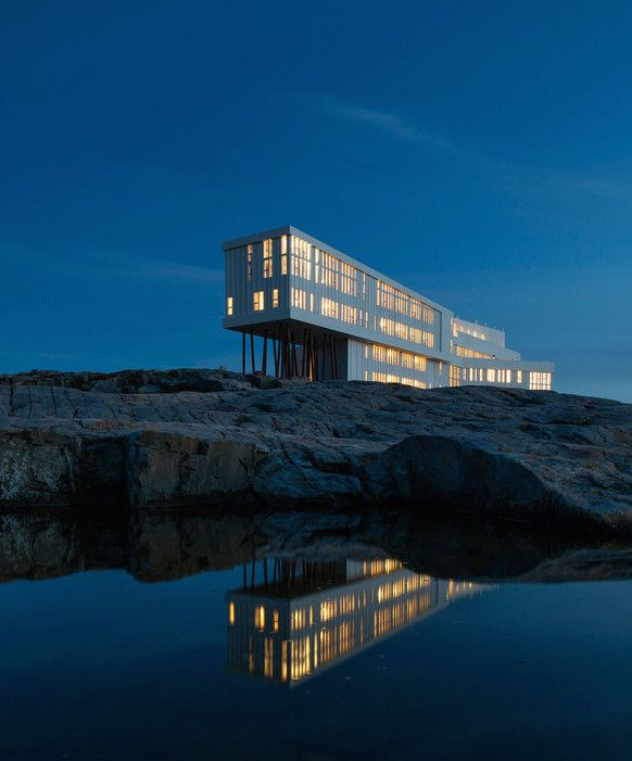 Canada's Fogo Island Inn - stop at or Nicole's Café if you're into a more casual experience—then plan your trip up Brimstone Head. Oh, and if you visit in late spring or summer, it's likely you'll spot a pod of migrating humpback whales while sea kayaking, or floating Arctic icebergs while hiking up Fogo Head.