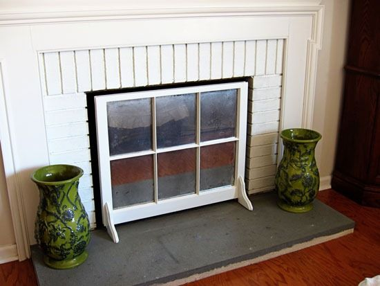 diy fireplace screen from an old window sash, brackets, little paint and Krylon Looking Glass Paint for the panes