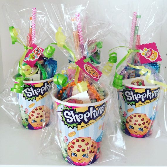 SET OF 10 Sending home a cute party favor with each guest is a nice way of saying Thank You. Each favor contains: 9oz Paper Shopkins Cup 1 Notepad ( design may vary) 1 Pencil ( colors/designs may vary) 1 Eraser( ice cream, donut, Popsicle or assorted food item design) 3 pieces of candy ( variety may vary) 2 pixy sticks ( candy) Paper straw ( colors may vary) 1 Shopkins tattoo 1 Plastic bangle bracelet ( colors/style may vary) Paper filler ( color may vary) Gift wrap, green and yellow…