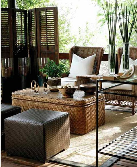 This elegant, neutral tone outdoor sitting room is finished out with woven furniture & tribal inspired accessories.