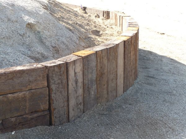 how to use railroad ties for retaining wall