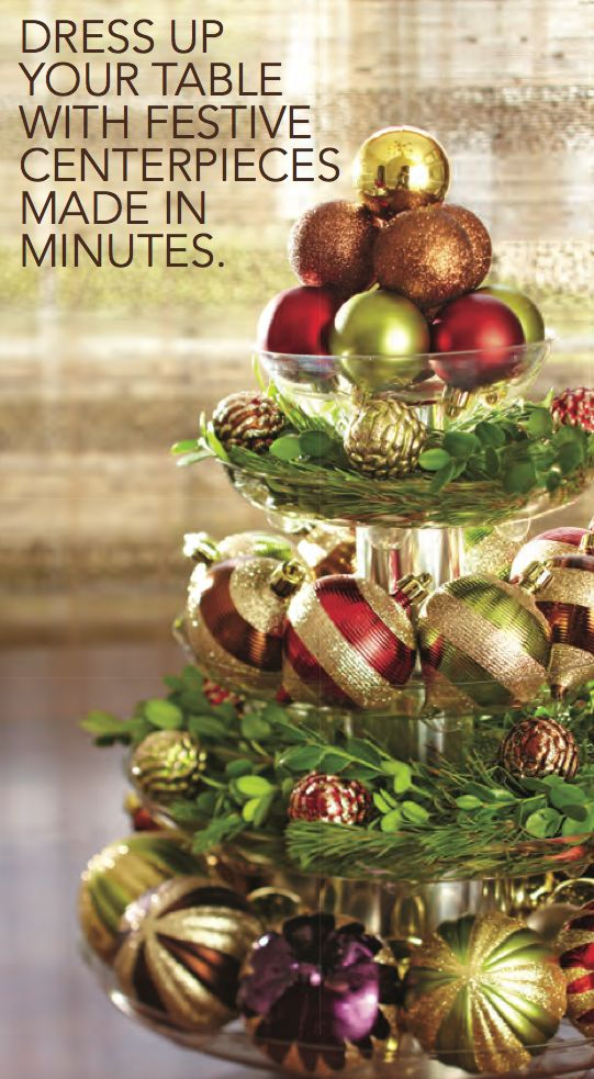 Pretty Easy Centerpiece Plastic Plant Saucers Filled With Colorful Ornaments And Greenery Make This Tabletop Tree Canned Goods Form The Base Of