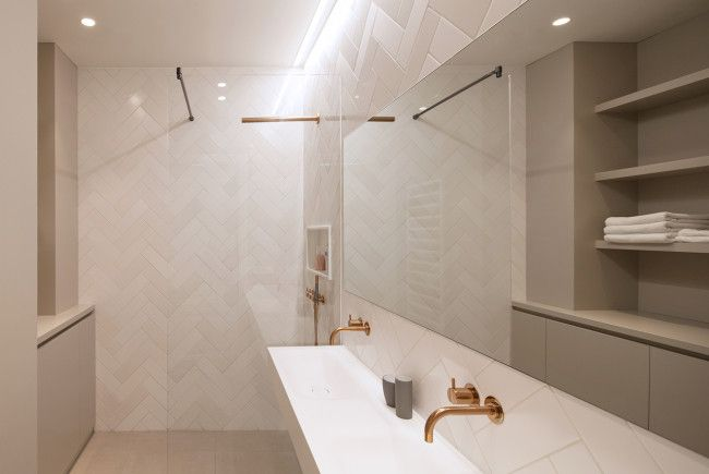 Bathroom. Copper faucets, Vola. Private home Amsterdam: interior design and project management by Heyligers design+projects. www.h-dp.nl