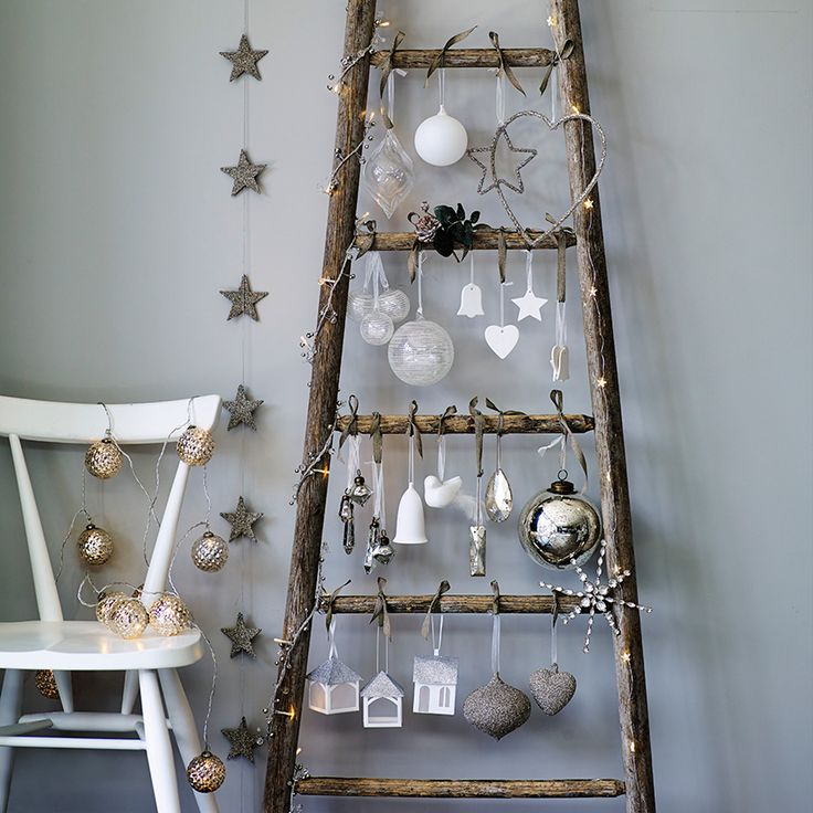 The White Company – An especially ingenious idea for small spaces, hang baubles and lights from a ladder propped against the wall. Decorations from £4 (thewhitecompany.com):