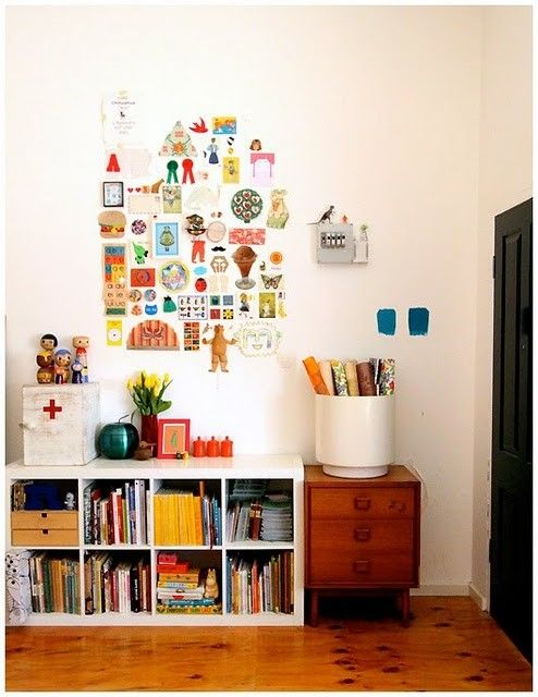 This playroom incorporates kids art in a cool collection that is pulled together and gallery-like.