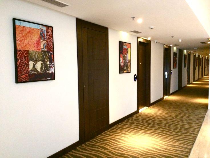 Canvas art feature at guest room corridors