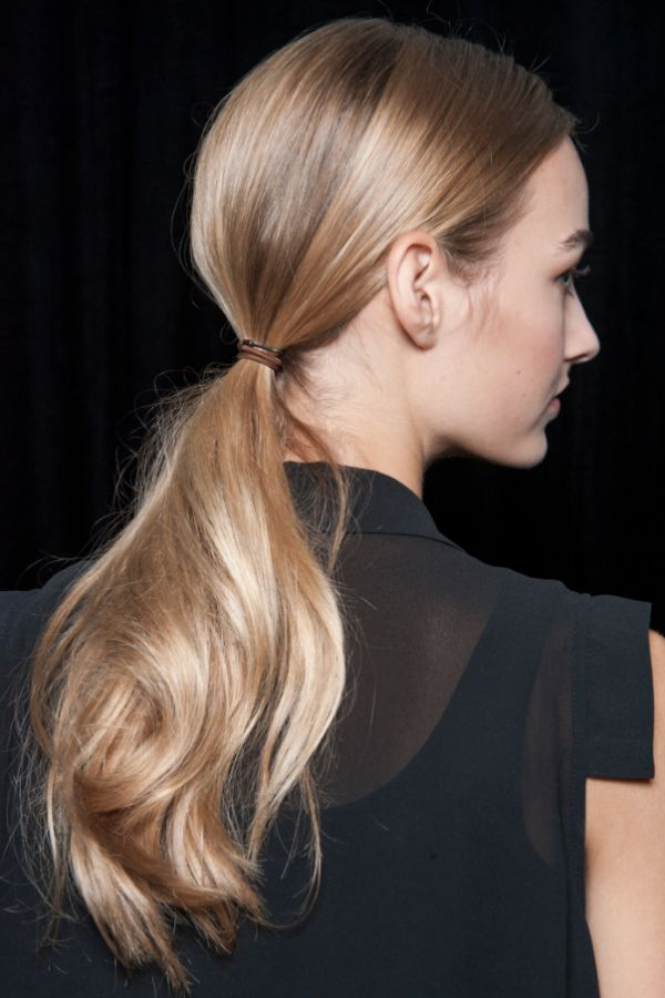 The Low Ponytail - As much as we love a perfectly imperfect topknot, there's something so refreshingly feminine about a loose, low-slung pony. For a burst of boldness, secure with a sleek, Céline-esque barrette.