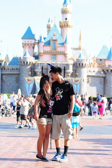 Kisses in Disney. i want a picture like this of me and kevin at Disneyland like this @Kati Kalmar McMahan