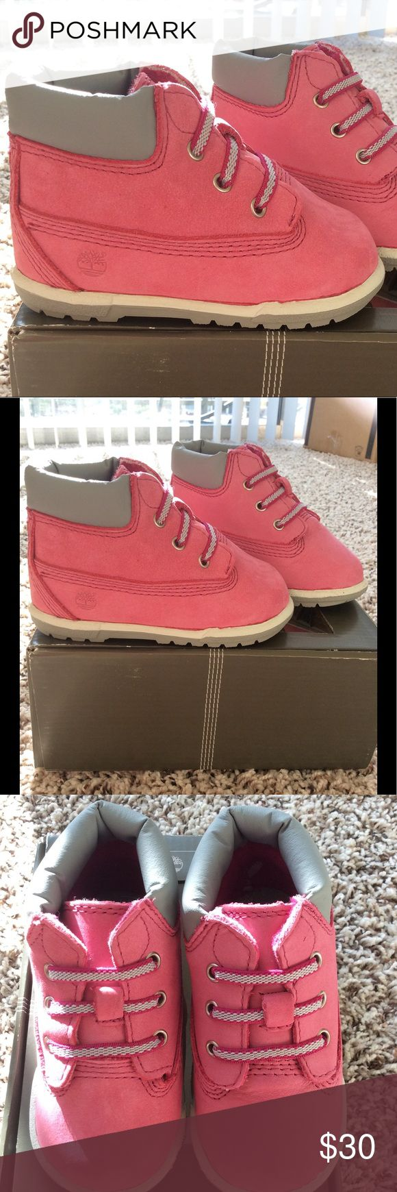 Infant Girl's Timberland Boots Adorable! Fuchsia pink nubuck leather. Gray rubber sole. Elastic, nonfunctional laces. Pull on. Removable insole to help determine fit. New without tags. Timberland Shoes Baby & Walker